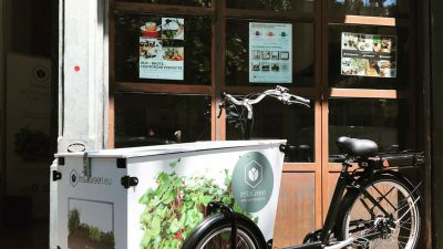 Various examples of InstaGreen branding and graphic design - cargobike and posters